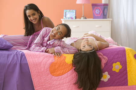 three girls: Three girls laying on bed