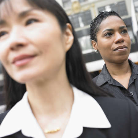 above 30: Close up of businesswomen standing