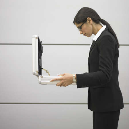 above 25: Businesswoman looking in briefcase