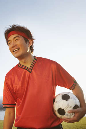 above 18: Man standing holding soccer ball