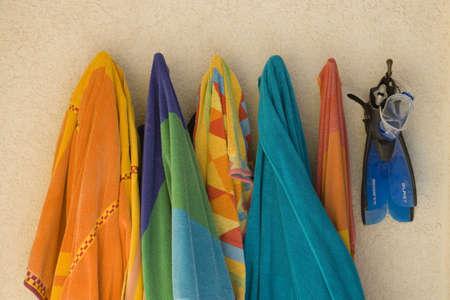 medium close up: Still life of beach towels on hooks LANG_EVOIMAGES