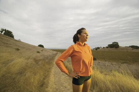 above 30: Portrait of woman jogging in country
