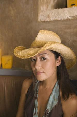 above 30: Portrait of woman wearing cowboy hat LANG_EVOIMAGES