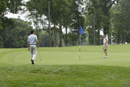 above 30: Couple playing golf