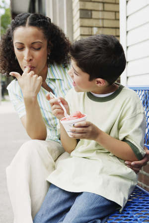 some under 18: Mother and son eating ice cream together LANG_EVOIMAGES