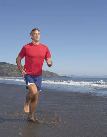 above 30: Man jogging at beach LANG_EVOIMAGES