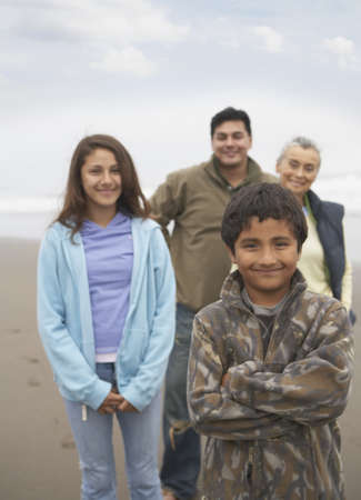 some under 18: Portrait of family standing at beach