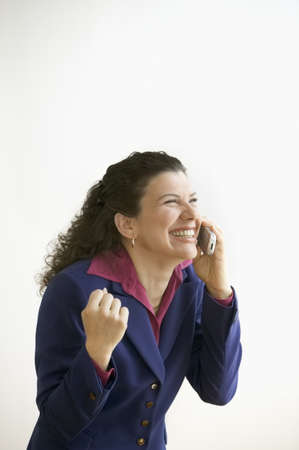 above 30: Woman talking on the phone laughing