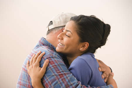 dad and daughter: Portrait of young adult woman hugging her father