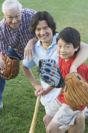 catcher's mitt: Portrait of family playing baseball LANG_EVOIMAGES