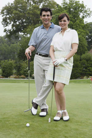 only mid adult women: Portrait of couple on golf course