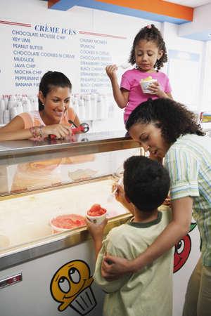 america's cup america: Family getting ice cream in ice cream shop