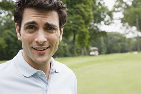 cynical: Close up portrait of man on golf course