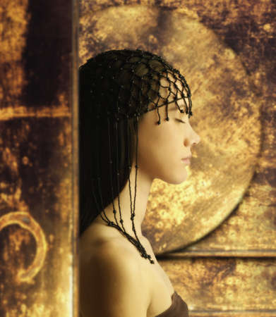 idealistic: Young woman wearing head beads