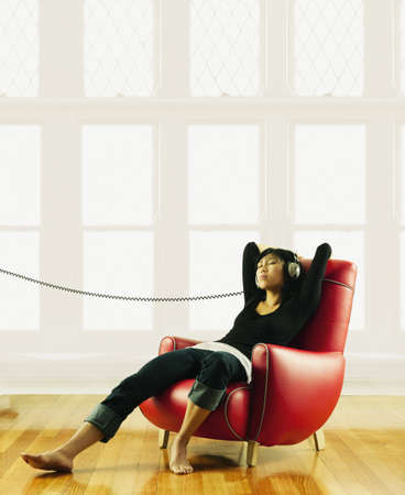 pacific islander ethnicity: Young woman relaxing and listening to headphones