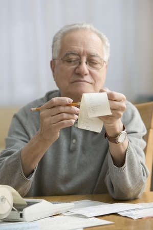 ninetys: Stressed older man doing his taxes