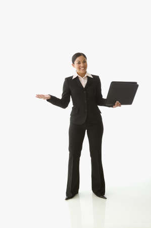 tugging: Businesswoman shrugging for the camera LANG_EVOIMAGES