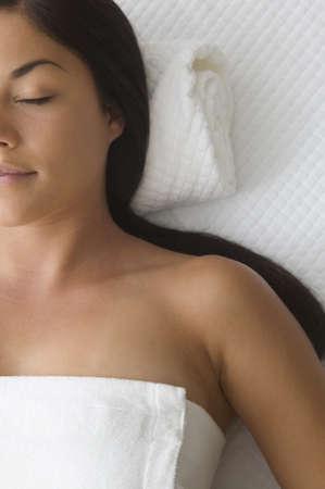 bathtowel: Young woman having a massage