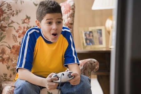 prevailing: Young boy playing video games