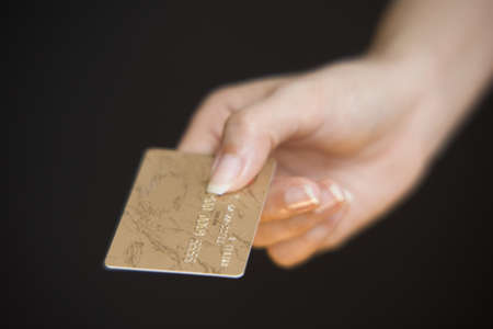 taking charge: Woman paying with a credit card LANG_EVOIMAGES