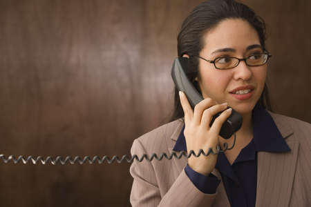 lower section view: Businesswoman talking on the phone