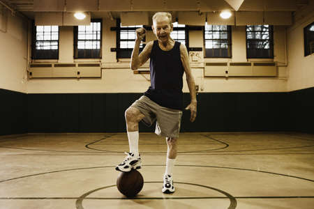 ninetys: Elderly man playing basketball