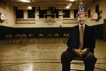 ninetys: Elderly man wearing a party hat