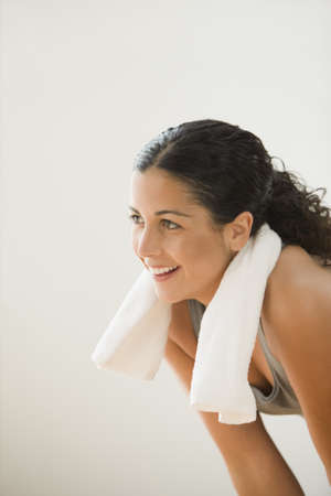 casualness: Sweating woman with a towel around her neck LANG_EVOIMAGES
