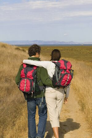 adventuresome: Rear view of couple hiking