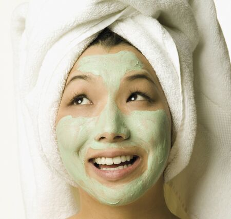 bathtowel: Young woman with face mask on LANG_EVOIMAGES