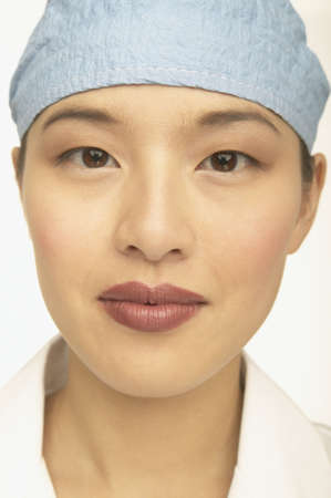 scrub cap: Close up of young female doctors face