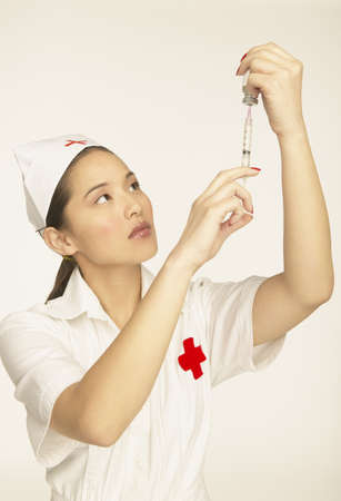 giver: Female nurse using a syringe