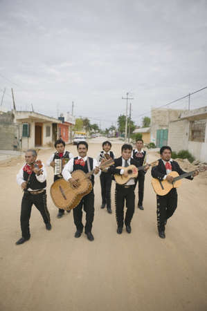 mariachi: Mariachi band walking and playing their instruments