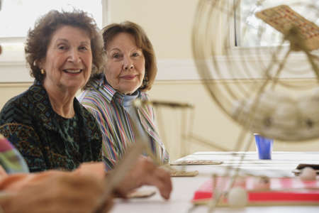 Elderly women playing bingo Stock Photo