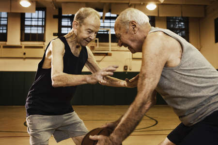 Elderly men playing basketball
