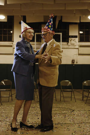 Elderly couple dancing in a gym