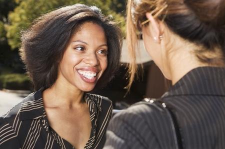 above 18: Two businesswomen talking