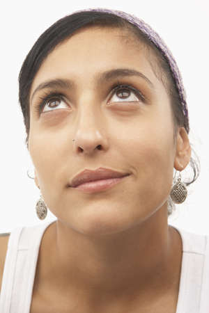 el salvadoran: Young woman looking up