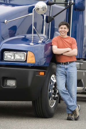 truck: Man standing next to truck