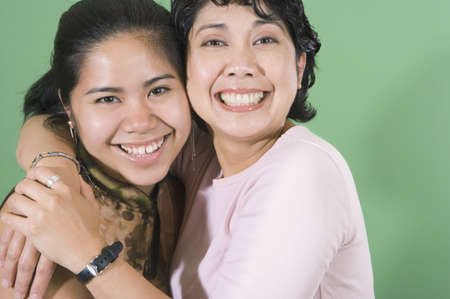 lighthearted: Mother and daughter smiling for the camera