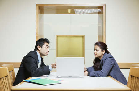 talkative: Executives in a meeting LANG_EVOIMAGES