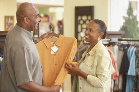 attentiveness: Couple shopping for clothing