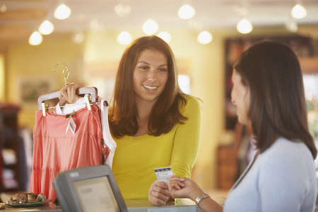 purchase: Woman purchasing clothing