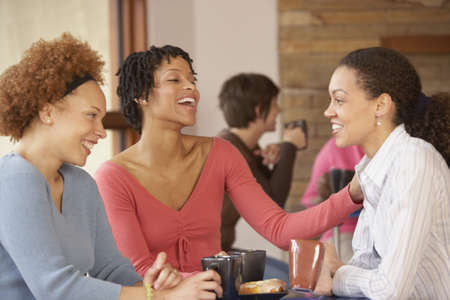 trick or treating: Three female friends in cafe drinking coffee