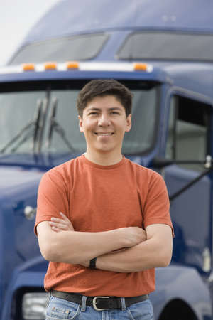 only mid adult men: Man standing in front of truck LANG_EVOIMAGES