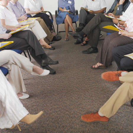 longshot: Detail view of business peoples legs in conference