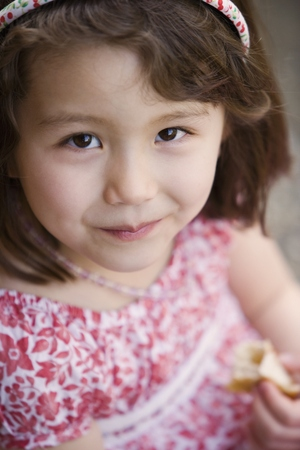 Close up portrait of girl eating