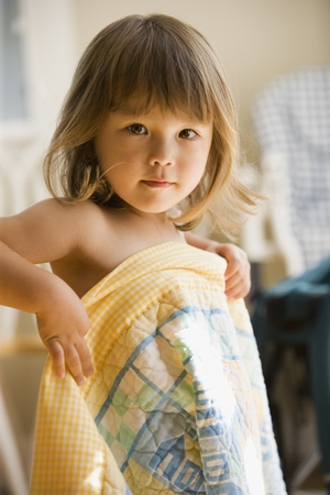 Portrait of girl with blanket