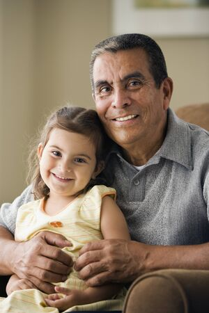 mid life: Portrait of grandfather with granddaughter