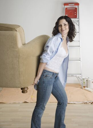 Portrait of woman moving furniture